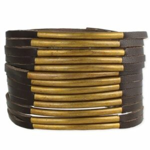 brown leather and gold metal wrist cuff